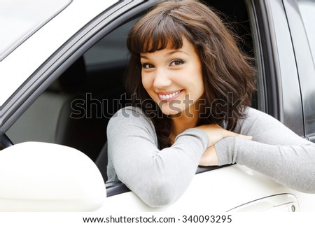 Pretty asian girl in a car  - stock photo
