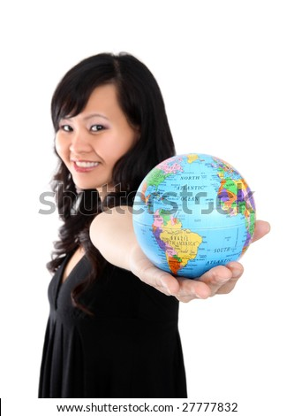 Pretty asian woman holding globe of world