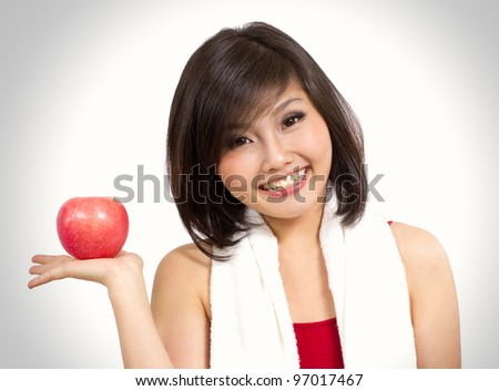pretty Asian woman showing an apple on her hand - stock photo