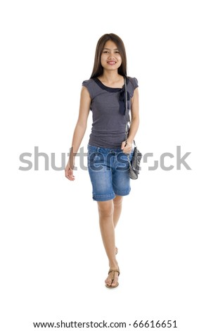 pretty asian woman walking, isolated on white background - stock photo