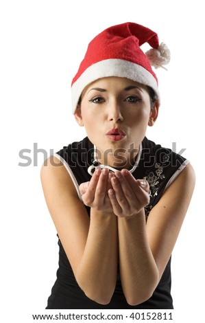 pretty asian woman with santa claus hat blowing on her hand - stock photo