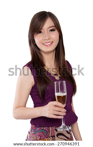 Pretty Asian young woman holding glass of champagne and smiling, isolated on white background - stock photo
