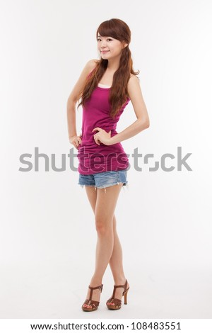Pretty Asian young woman studio full shot isolated on white background. - stock photo