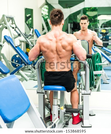 pretty athletically built sportsman is engaged in the gym
