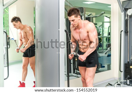 pretty athletically built sportsman is engaged in the gym - stock photo