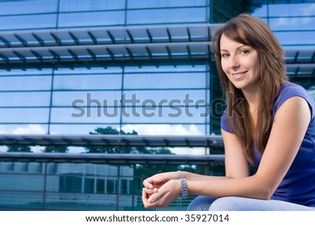 Pretty attractive caucasian girl sitting relaxing outside college school - stock photo