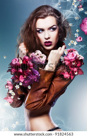 pretty attractive erotic woman in brown jacket with flowers - stock photo