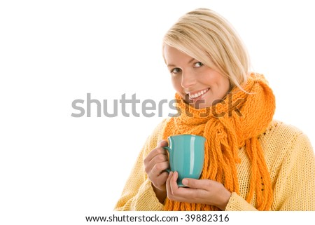 Pretty autumnal woman holding mug with hot beverage isolated on white background - stock photo