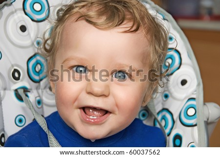 pretty baby boy laughing portrait closeup - stock photo