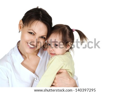pretty baby girl and pediatrist doctor on white background