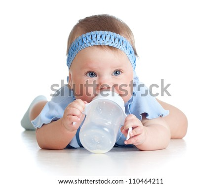 Pretty baby girl drinking milk from bottle. 8 months old. - stock photo