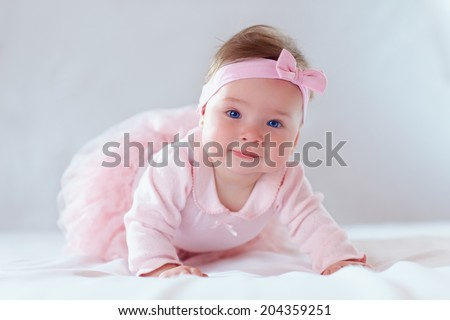 pretty baby girl in pink dress - stock photo