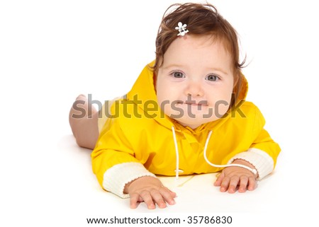 Pretty baby girl in yellow, looking into camera