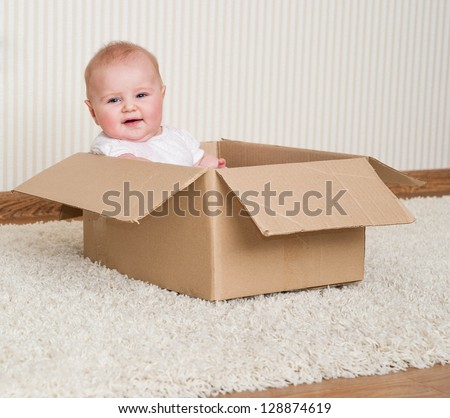 pretty baby girl inside a box - stock photo