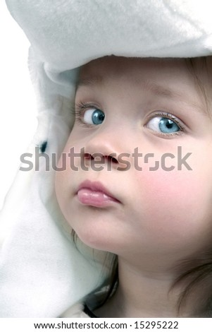 Pretty baby girl portrait wearing white hat - stock photo