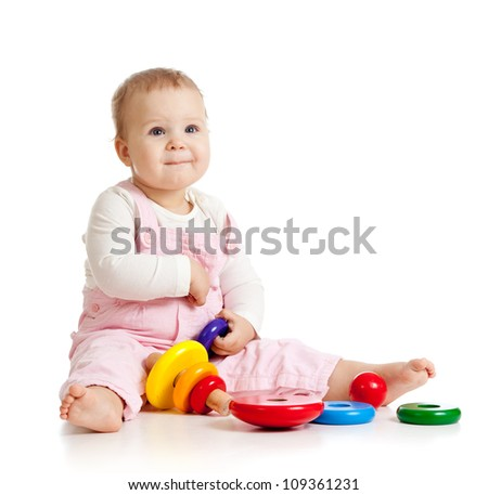 pretty baby or kid playing with color toy - stock photo