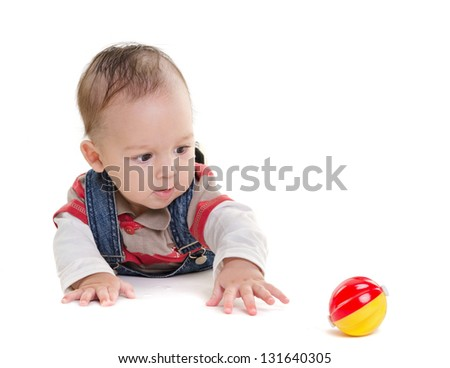 pretty baby plays on a white - stock photo