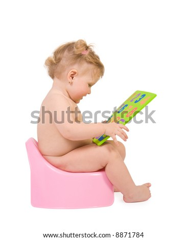 Pretty baby sit on pink potty and look to digits toy. Isolate on white - stock photo