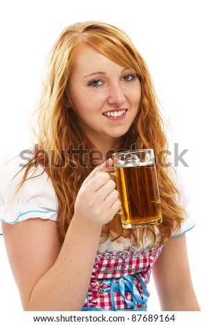 pretty bavarian girl with a glass of beer on white background - stock photo