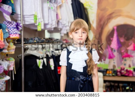 Pretty beautiful girl chooses clothes in shop - stock photo