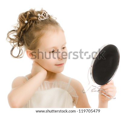 Pretty beautiful girl looks in the mirror on a white background. - stock photo