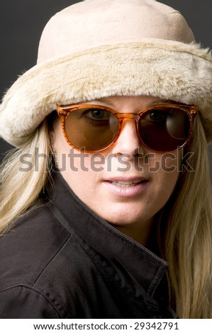 pretty beautiful middle age blond woman retro vintage sunglasses and hat