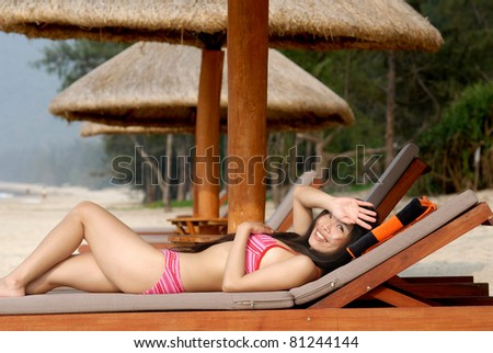 pretty bikini girl sunbathing on summer beach - stock photo