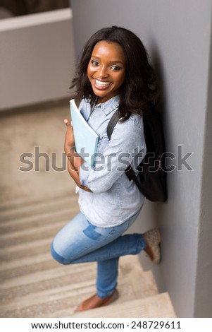 pretty black college girl looking at the camera - stock photo