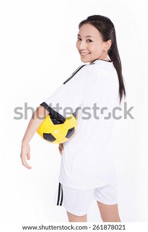 pretty black hair woman holding ball on white background - stock photo