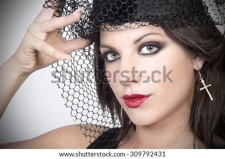 pretty black widow with a veil - stock photo