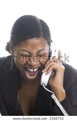 pretty black woman angry while talking on telephone - stock photo
