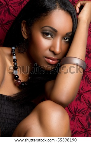 Pretty black woman closeup portrait - stock photo