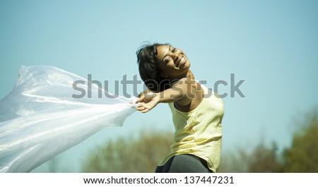 pretty black woman enjoying summer in the park - stock photo