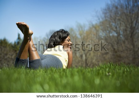 pretty black woman enjoying summer in the park
