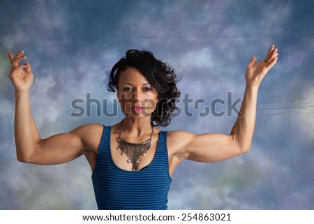 Pretty black woman flexing her muscles