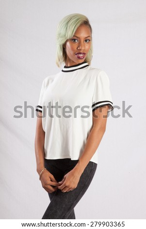 Pretty black woman in a white blouse, looking thoughtful
