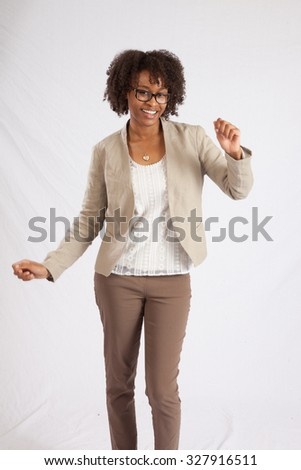Pretty black woman in glasses looking happy with a smile - stock photo
