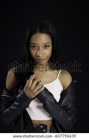 Pretty Black woman in leather jacket  smiling at the camera
