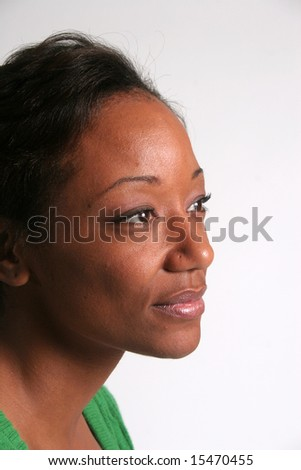 Pretty black woman looking to the right and thinking - stock photo