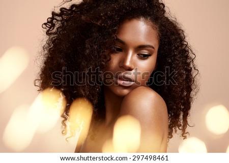pretty black woman's portrait with bokeh - stock photo