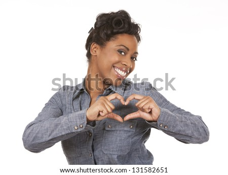 pretty black woman showing heart sign on white background - stock photo