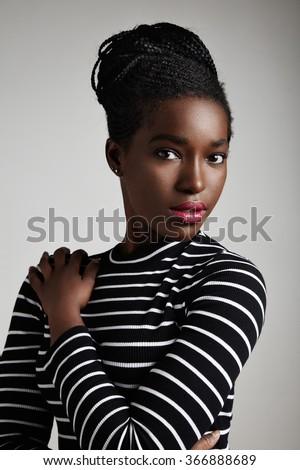 pretty black woman watching at camera - stock photo
