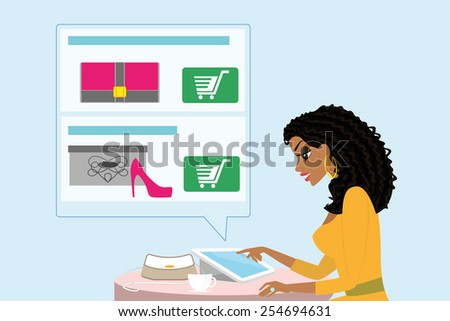 Pretty blackhair woman sitting alone in the cafe and doing shopping online. - stock photo