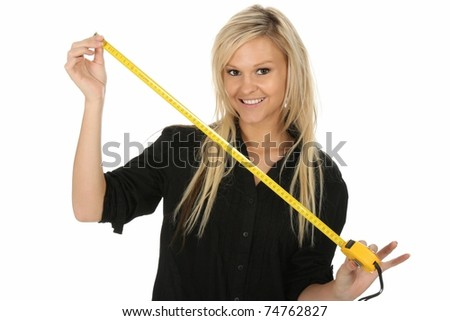 Pretty blond beauty girl with a yellow tape measure - stock photo