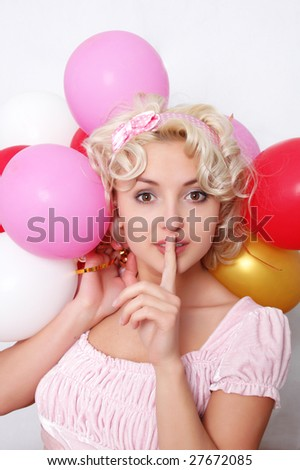 pretty blond girl holding balloons