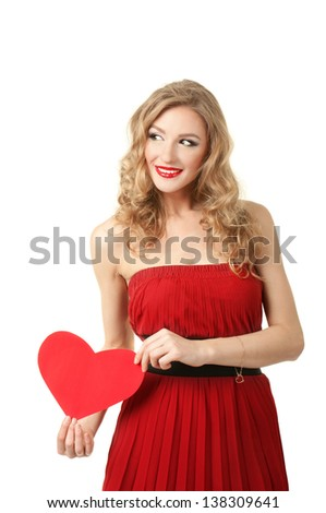 Pretty blond girl holding heart shape  - valentine day concept - stock photo