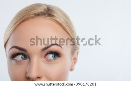 Pretty blond girl is expressing her interest - stock photo