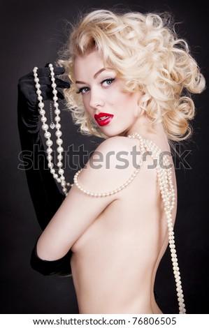 Pretty blond girl model like Marilyn Monroe red lips on black background - stock photo