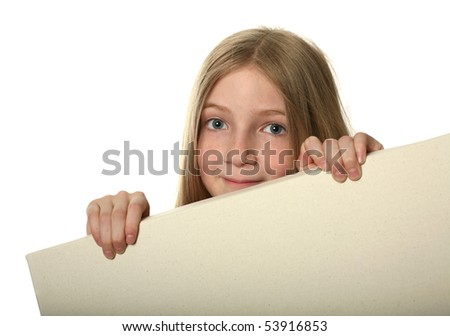 Pretty blond girl peeping over a blank billboard isolated on white - stock photo