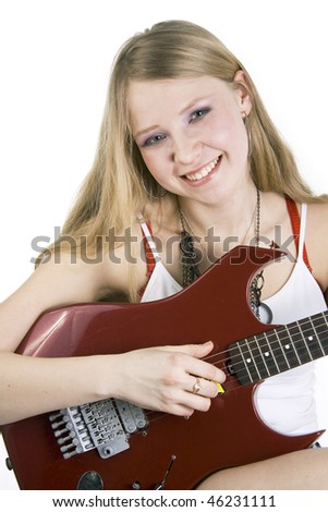 Pretty blond girl playing a red electric guitar isolated on a white background - stock photo